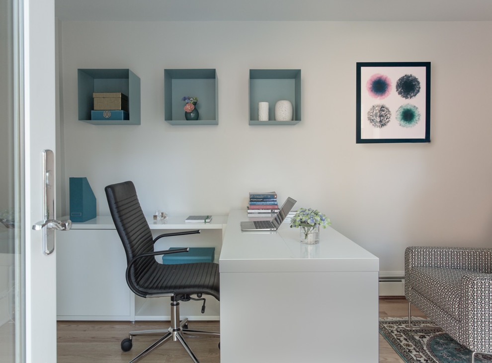 Mid-sized transitional freestanding desk medium tone wood floor study room photo in Boston with white walls and no fireplace