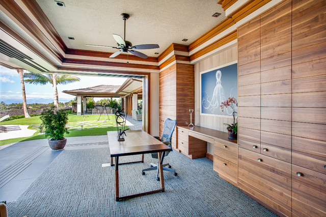 example of an island style built-in desk home office design in vancouver outside r