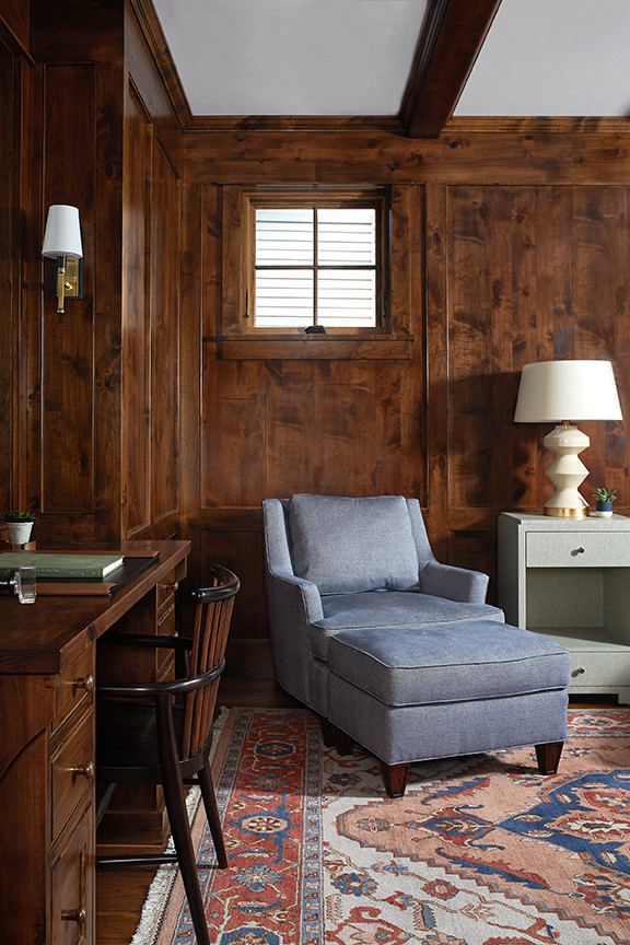 Example of a small beach style freestanding desk dark wood floor and brown floor study room design in Grand Rapids with brown walls