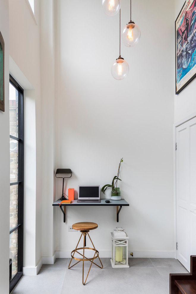 Small trendy built-in desk ceramic tile and gray floor study room photo in London with no fireplace and white walls