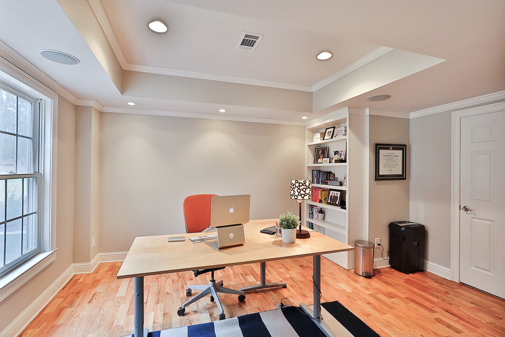 Mid-sized transitional freestanding desk light wood floor study room photo in Atlanta with gray walls and no fireplace