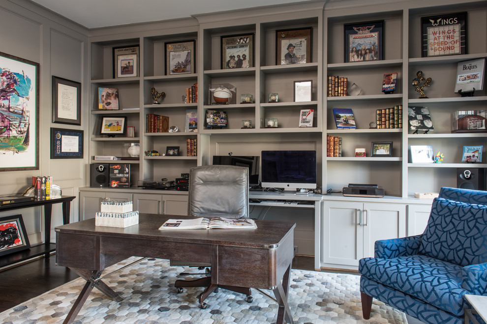transitional style home office with blue accent chair