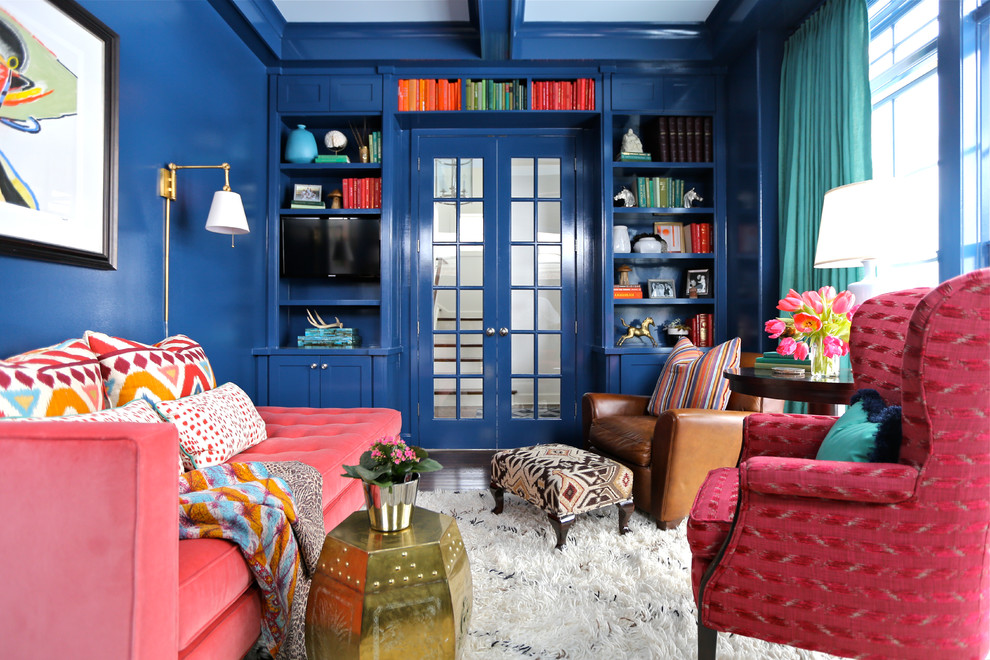 Example of an eclectic dark wood floor home office design in Chicago with blue walls