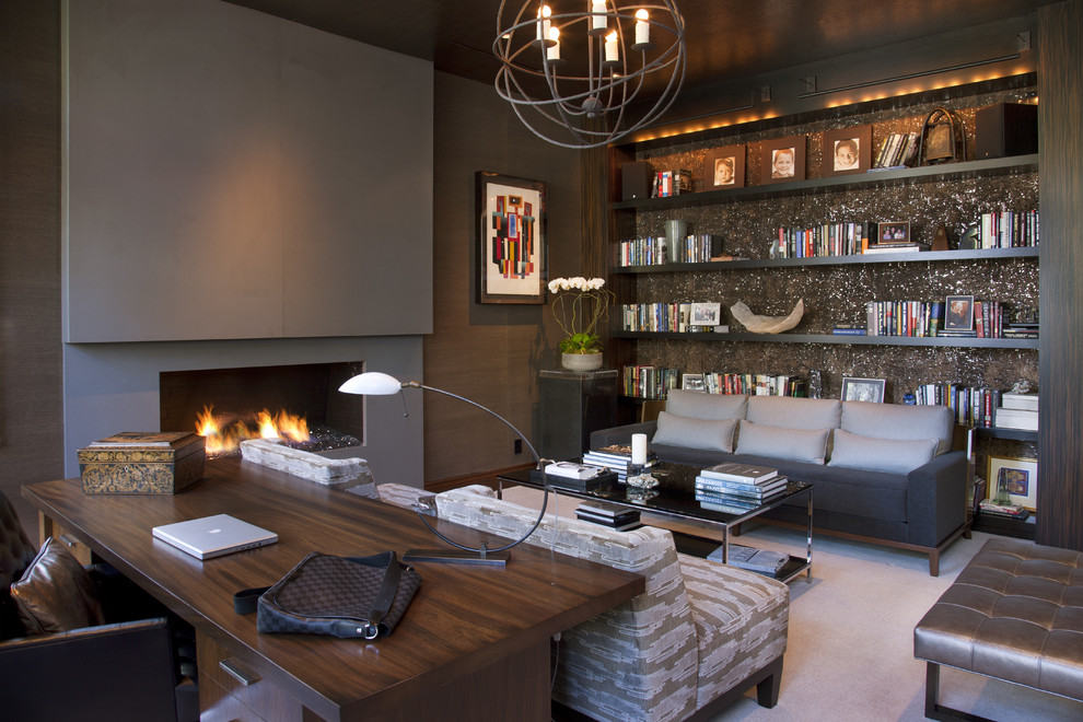 Example of a trendy freestanding desk carpeted home office design in San Diego with a ribbon fireplace