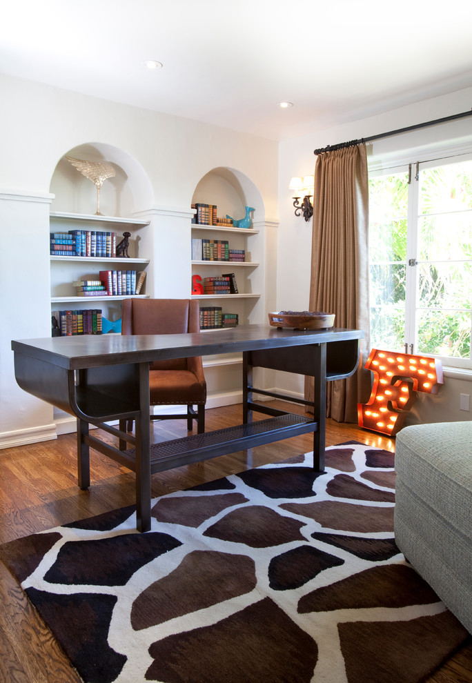 Transitional freestanding desk dark wood floor home office photo in Los Angeles with white walls