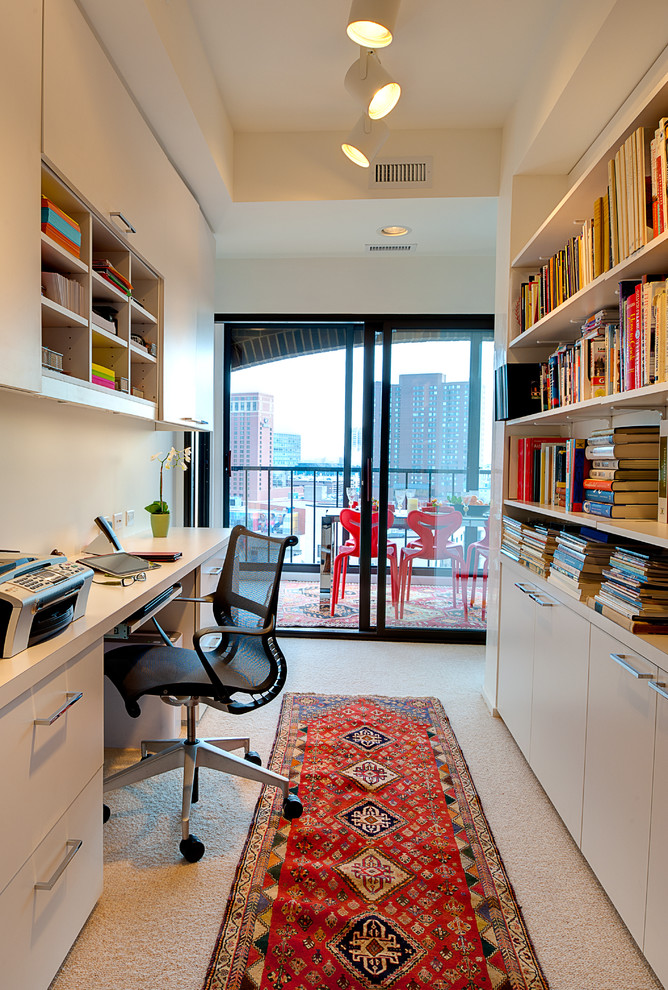 Home office - contemporary built-in desk carpeted home office idea in Minneapolis with white walls