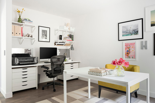 Example of a mid-sized transitional built-in desk medium tone wood floor home office design in Los Angeles with white walls