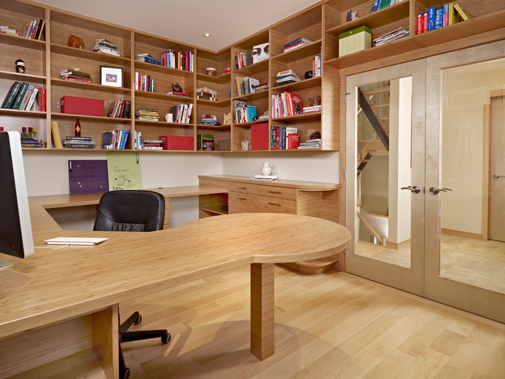 Example of a trendy home office design in Edmonton with white walls