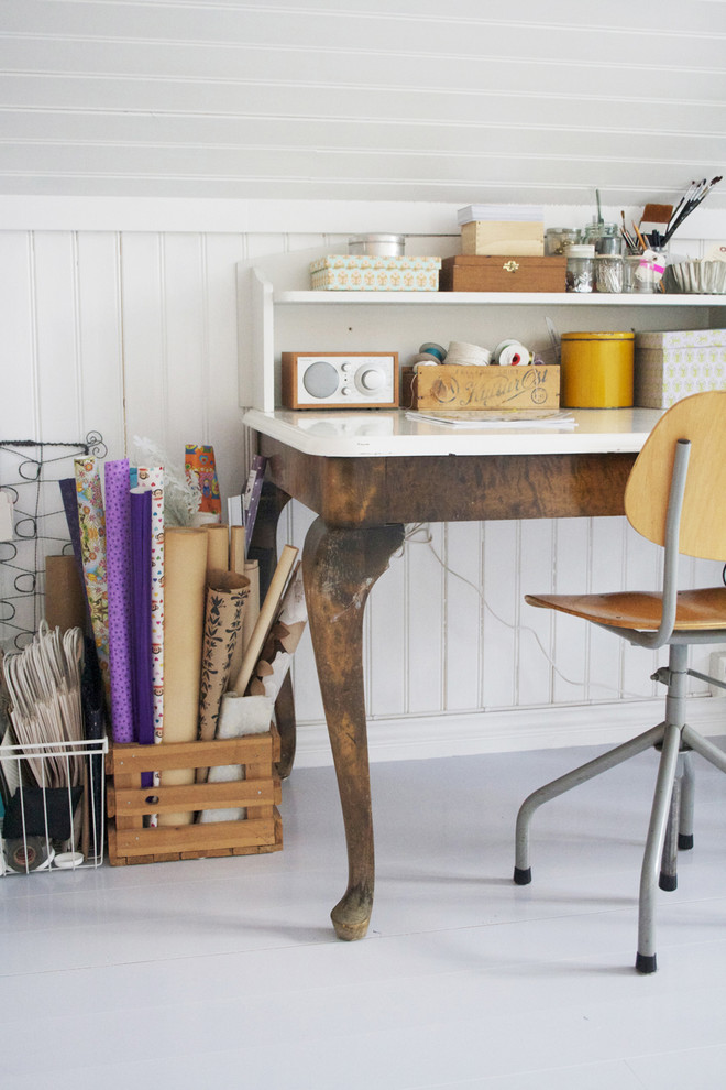 Example of a cottage chic freestanding desk home office design in Other with white walls