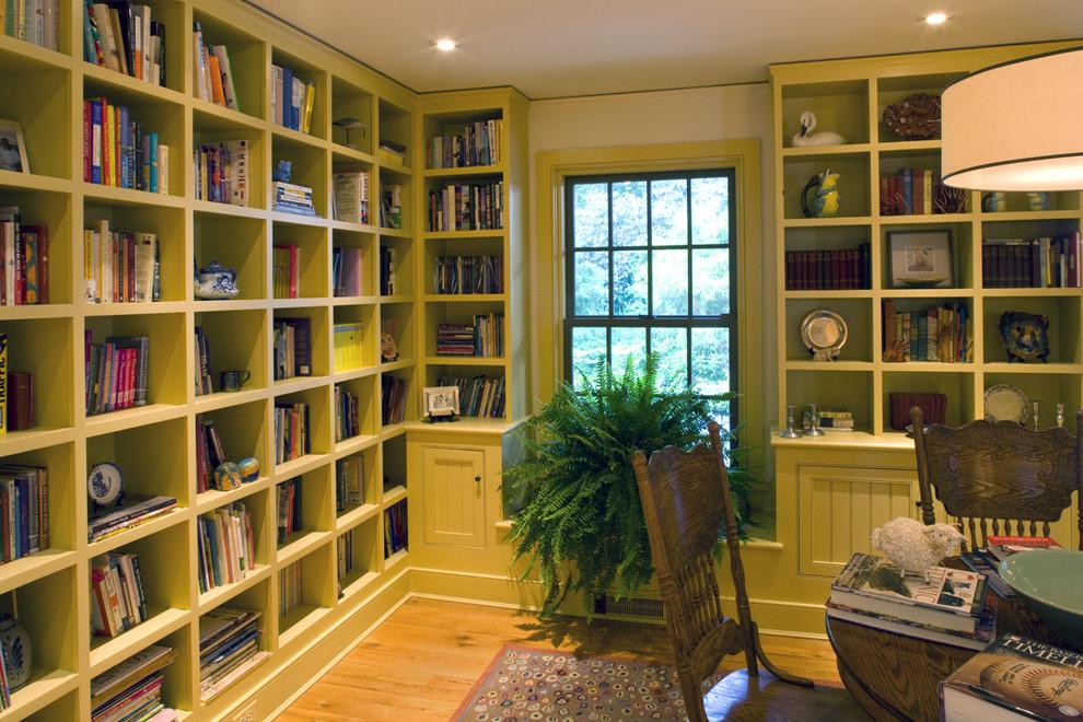 Elegant medium tone wood floor home office photo in Philadelphia with white walls