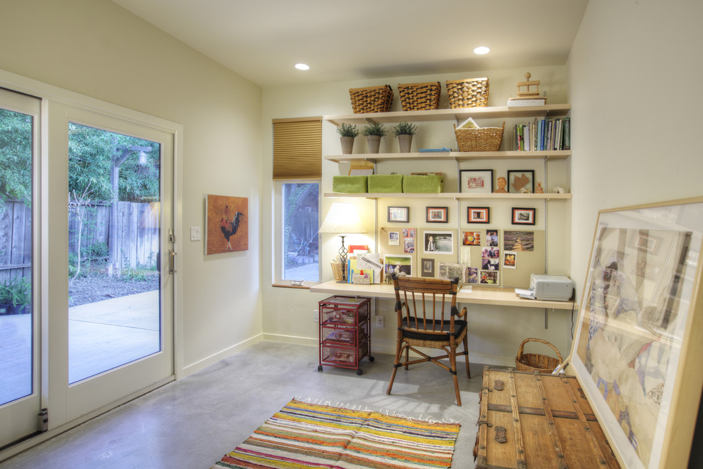 Mid-sized trendy built-in desk concrete floor and gray floor home office photo in Sacramento with white walls and no fireplace