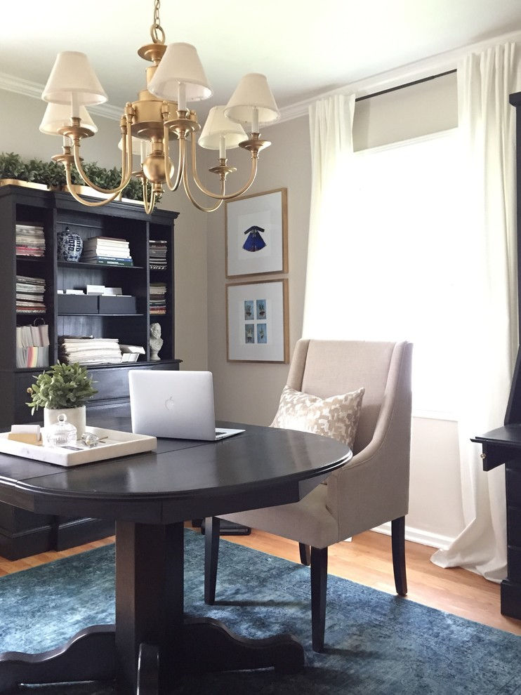 Example of a small transitional freestanding desk light wood floor home office design in Denver with gray walls and no fireplace