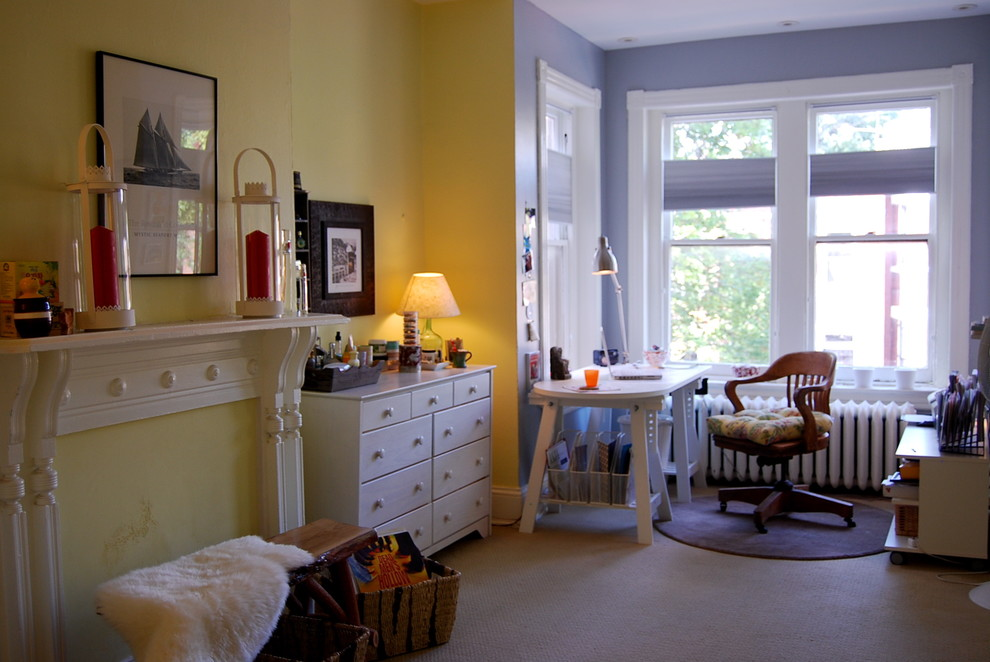 Home office - eclectic freestanding desk carpeted home office idea in DC Metro with yellow walls
