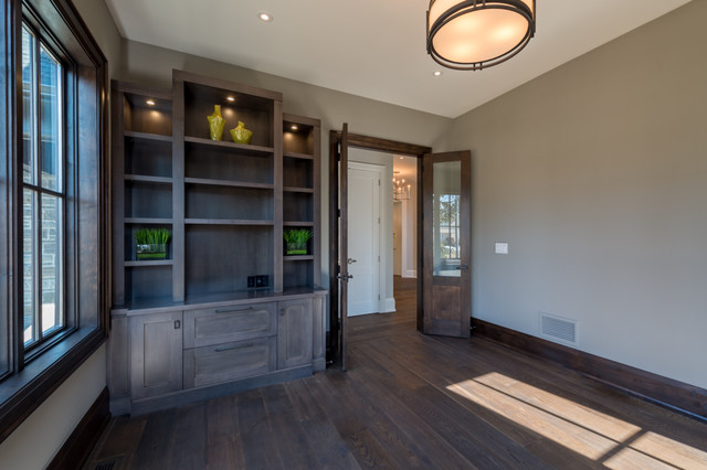 Inspiration for a mid-sized transitional medium tone wood floor study room remodel in Toronto with gray walls