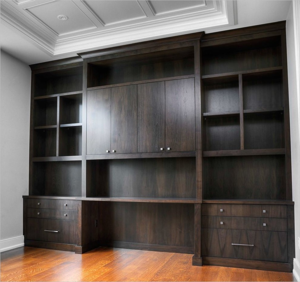 Mid-sized transitional built-in desk light wood floor study room photo in Toronto with gray walls and no fireplace