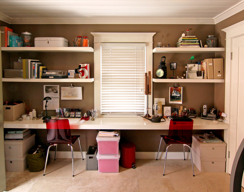 Example of a transitional home office design in Orange County