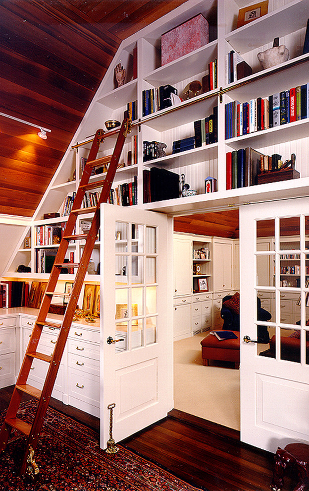Example of a classic dark wood floor home office design in Boston
