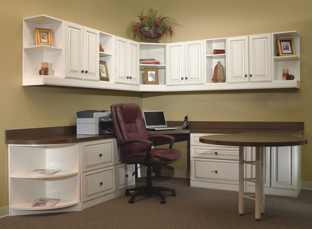 home office with extended round table and lots of storage