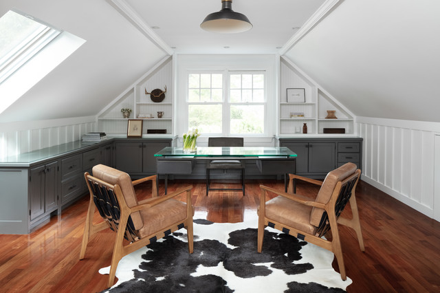 Example of a cottage freestanding desk dark wood floor and brown floor study room design in Boston with white walls and no fireplace