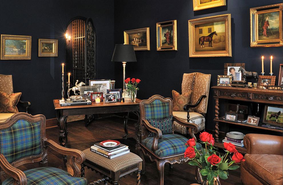 Mid-sized elegant freestanding desk medium tone wood floor home office photo in Houston with black walls