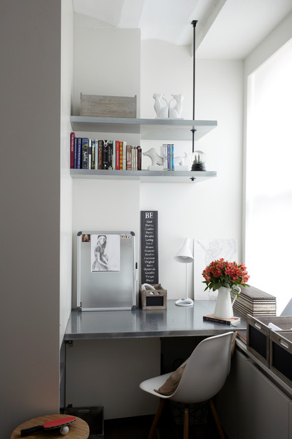 Inspiration for a contemporary built-in desk home office remodel in New York with white walls