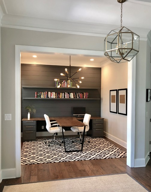 Mid-sized trendy built-in desk dark wood floor and brown floor study room photo in Charlotte with gray walls