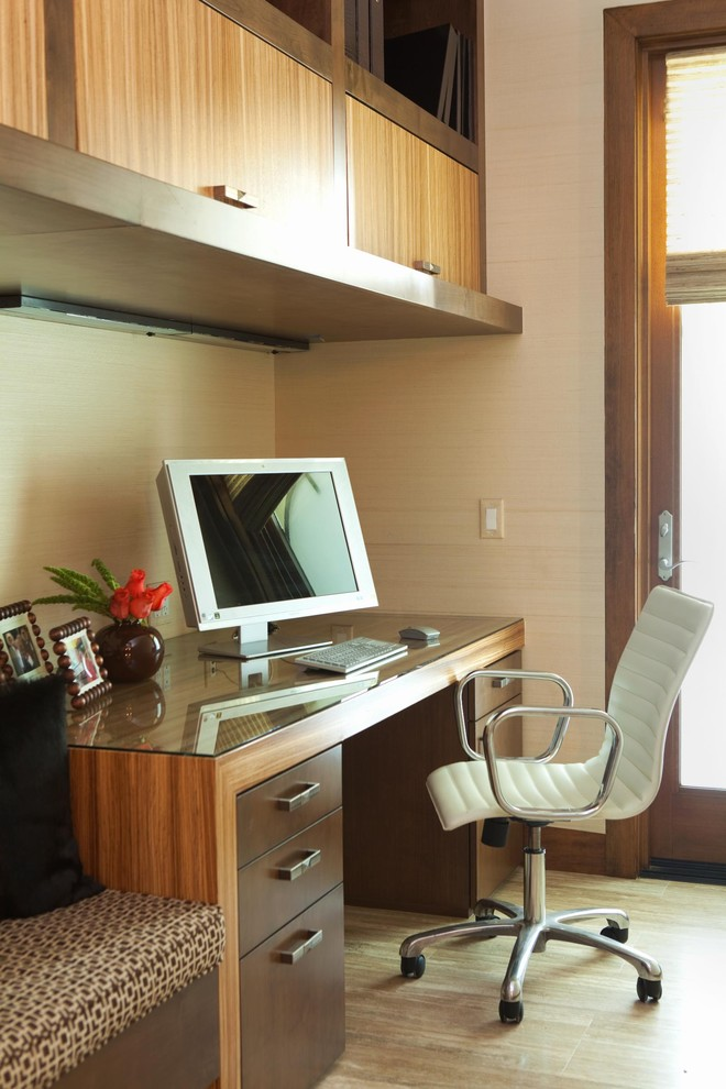 Home office - contemporary built-in desk home office idea in Orange County