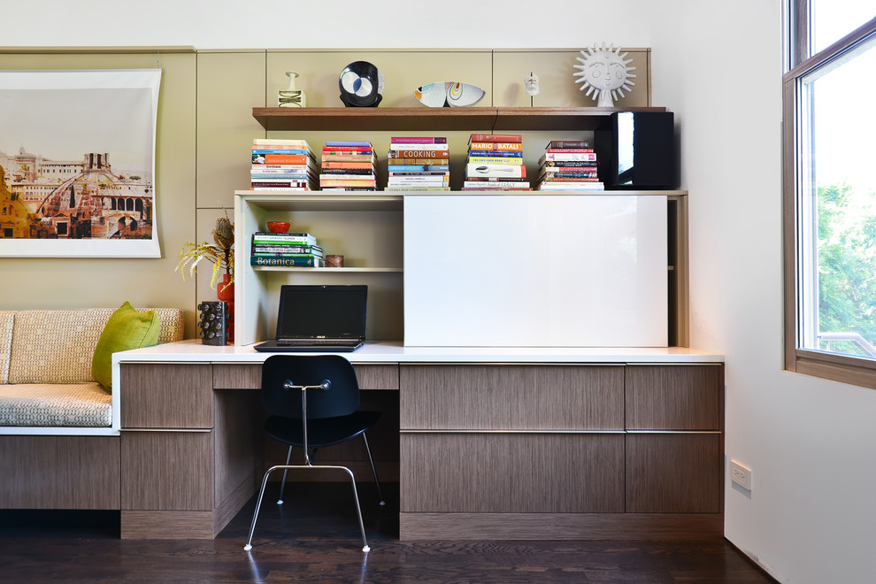 Inspiration for a large contemporary built-in desk dark wood floor home office remodel in Chicago with white walls