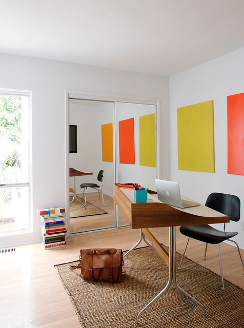 Inspiration for a mid-sized midcentury modern freestanding desk light wood floor and brown floor home office remodel in Los Angeles with white walls and no fireplace