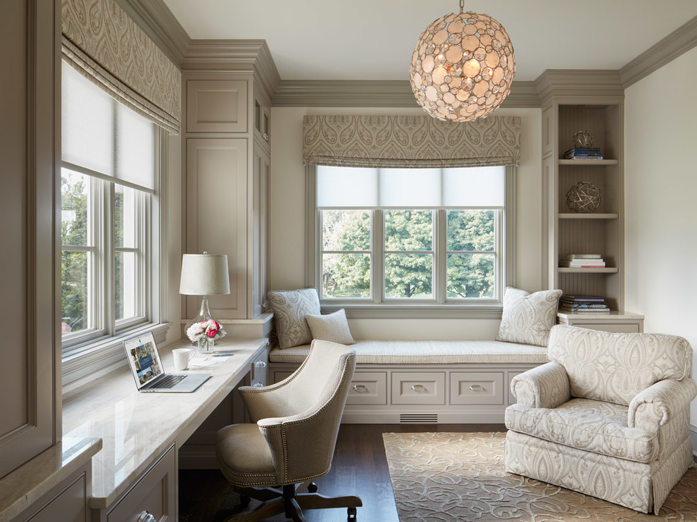 Study room - traditional built-in desk dark wood floor study room idea in Chicago with white walls