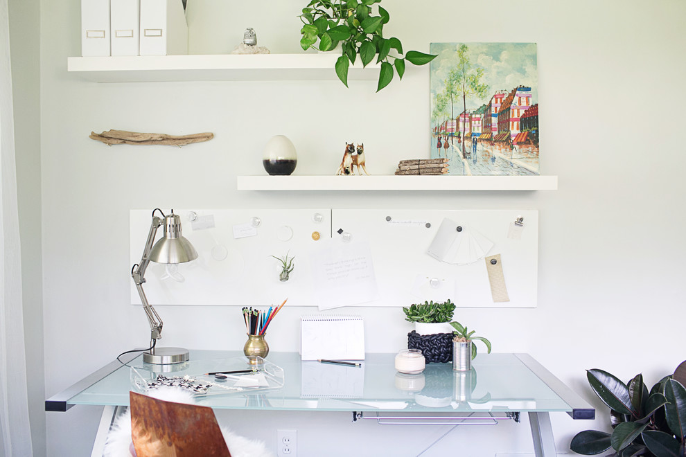 Inspiration for a 1960s freestanding desk home office remodel in New York with white walls