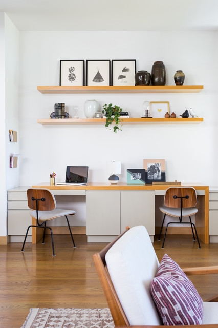 Example of a mid-sized trendy built-in desk medium tone wood floor and brown floor home office design in Los Angeles with white walls and no fireplace