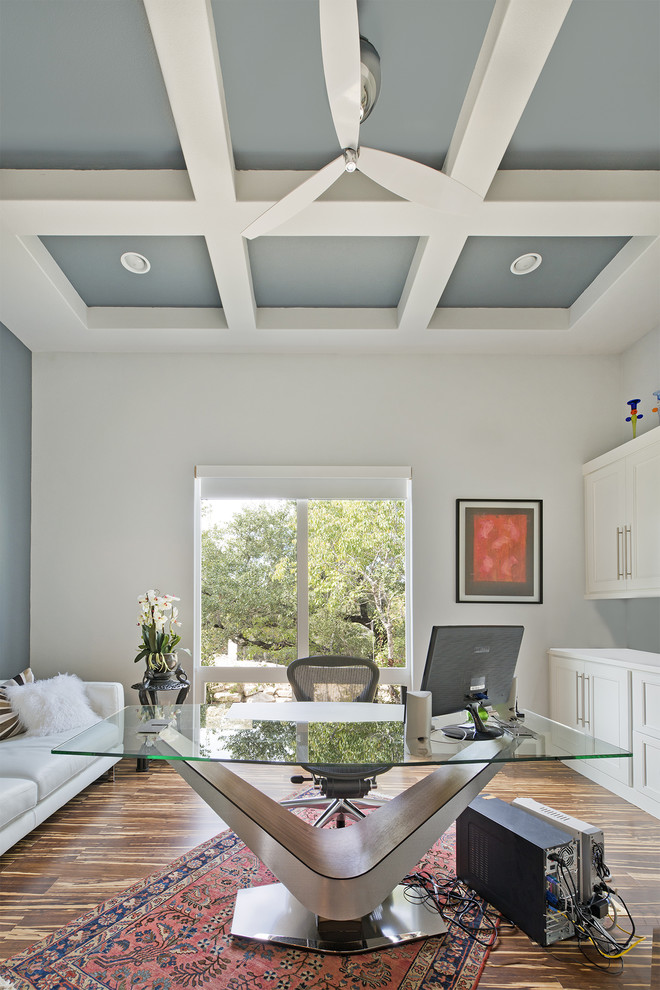 Example of a transitional freestanding desk medium tone wood floor home office design in Austin with white walls