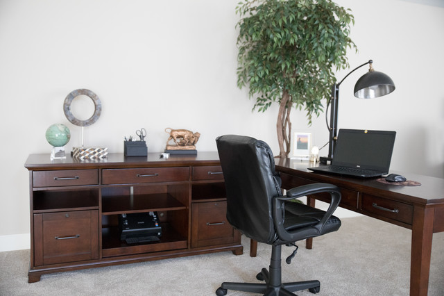 Inspiration for a mid-sized transitional freestanding desk carpeted and beige floor home office remodel in Other with beige walls