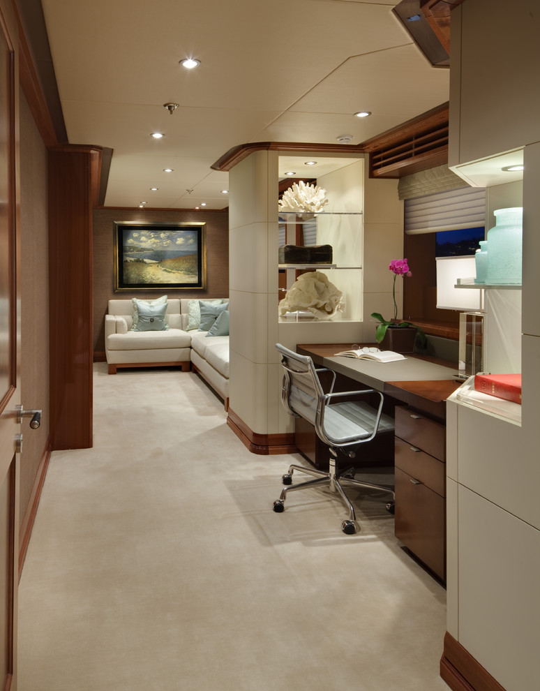 Example of a trendy built-in desk carpeted home office design in Seattle
