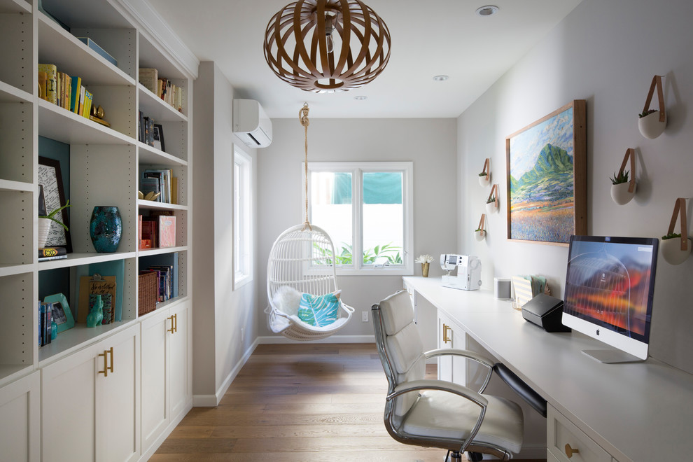 Inspiration for a transitional built-in desk medium tone wood floor and brown floor study room remodel in Hawaii with gray walls