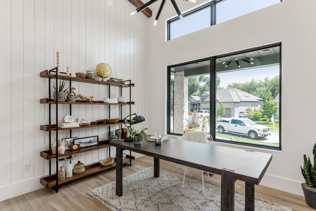 Inspiration for a mid-sized contemporary freestanding desk porcelain floor and brown floor study room remodel in Salt Lake City with white walls and no fireplace