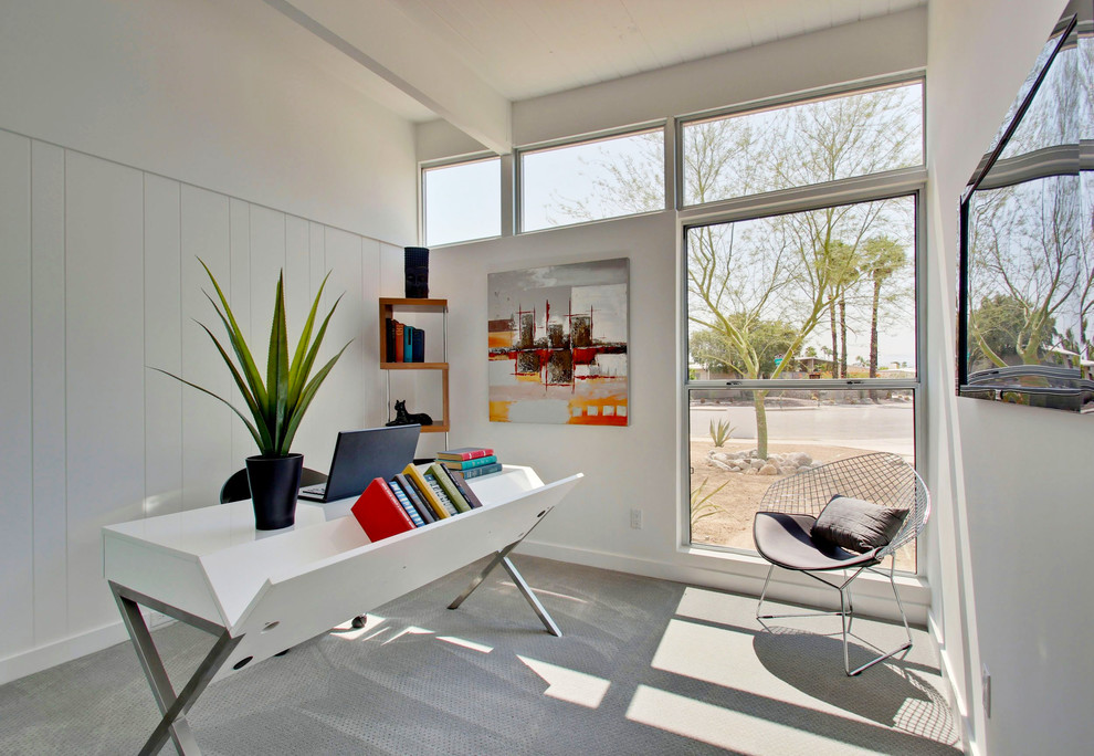 Home office - mid-sized 1950s freestanding desk carpeted home office idea in Other with white walls
