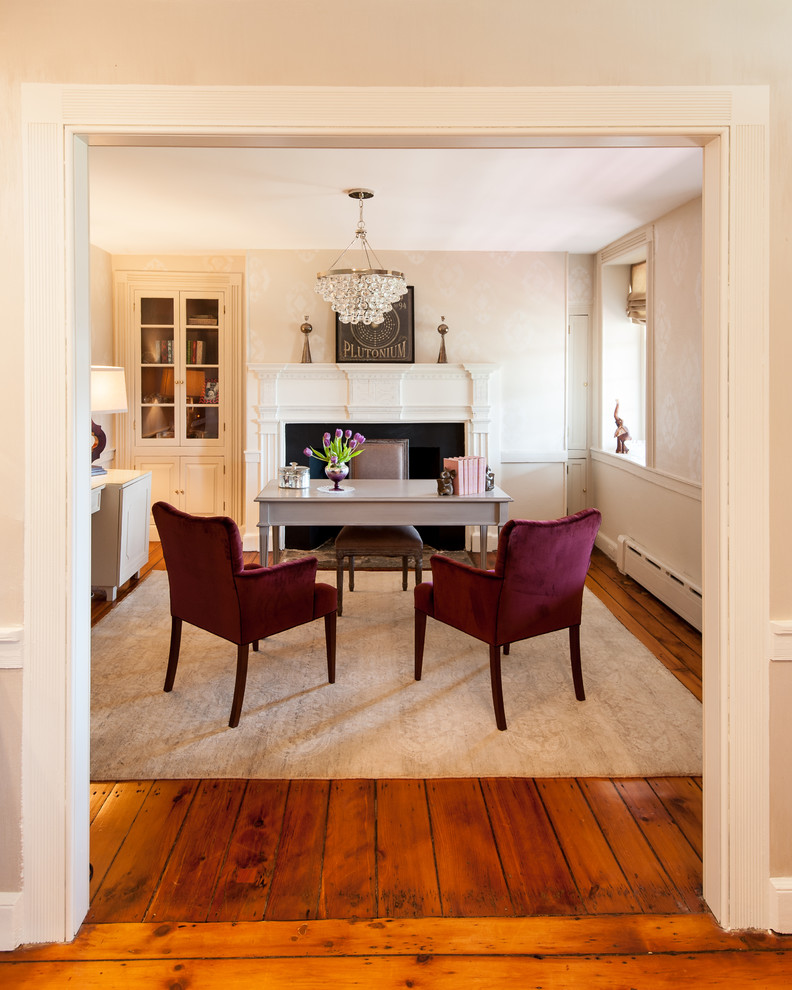 Inspiration for a mid-sized cottage freestanding desk medium tone wood floor and brown floor study room remodel in Philadelphia with beige walls, a standard fireplace and a stone fireplace
