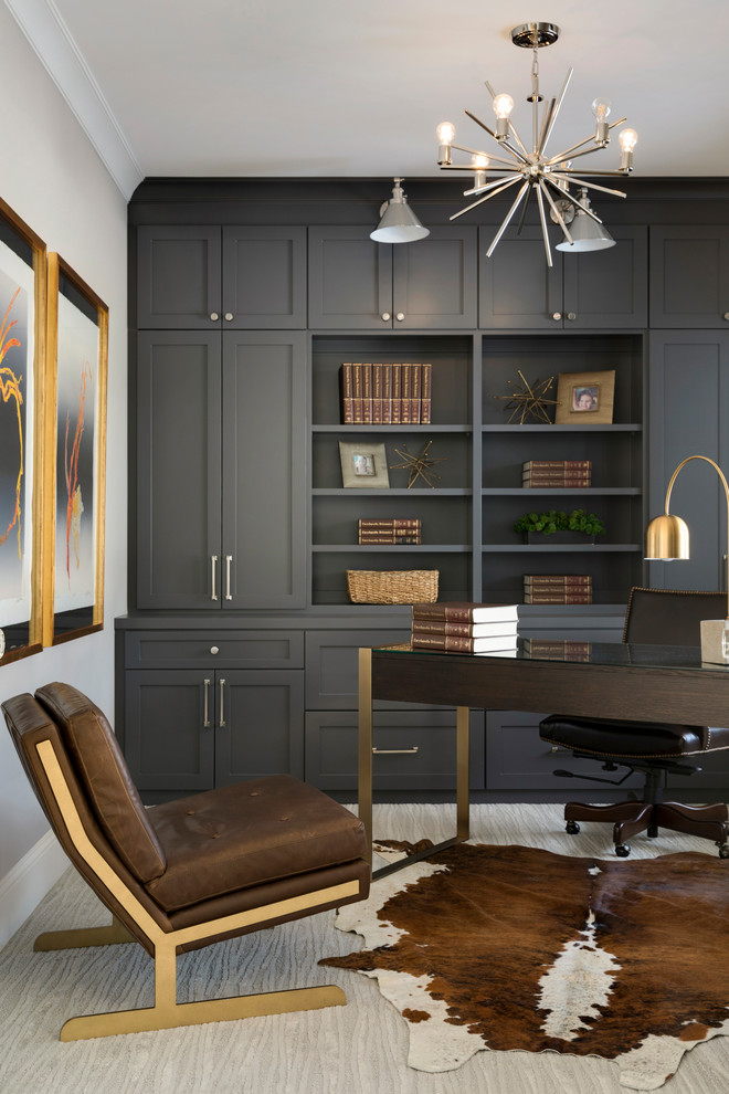 Home office library - transitional freestanding desk carpeted and beige floor home office library idea in Minneapolis with beige walls