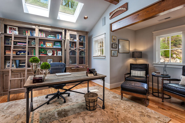 Inspiration for a large traditional home office and library in Other with a reading nook, grey walls, medium hardwood flooring, no fireplace and a freestanding desk.
