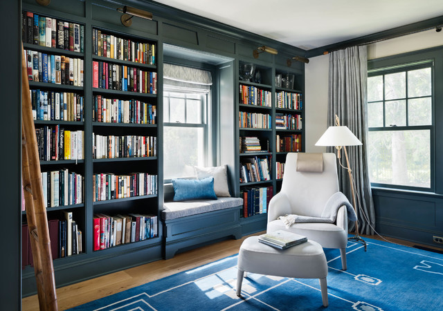 Example of a large coastal freestanding desk light wood floor and blue floor home office library design in New York with yellow walls