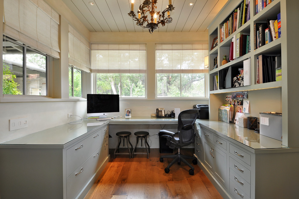 Inspiration for a contemporary built-in desk home office remodel in Austin