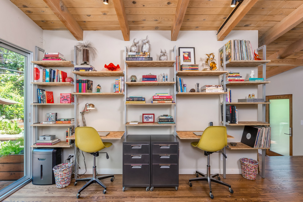 Inspiration for a 1950s built-in desk medium tone wood floor study room remodel in Los Angeles with white walls