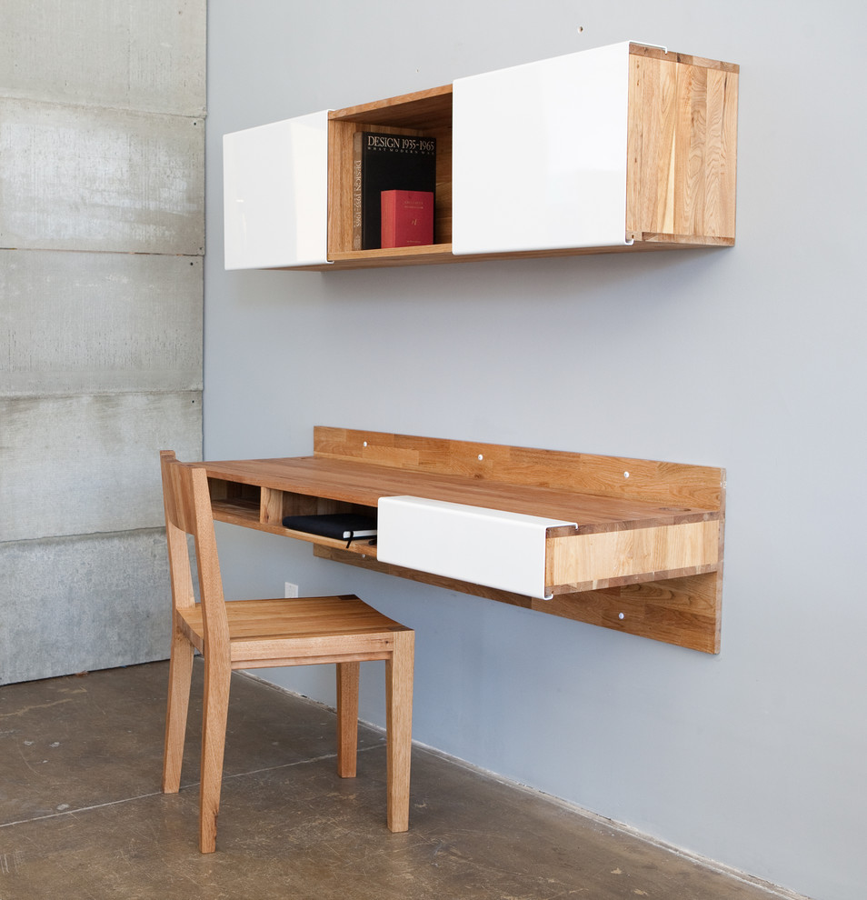 Study room - small modern built-in desk concrete floor study room idea in Los Angeles with gray walls
