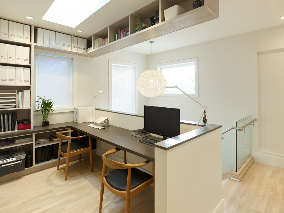 Example of a small trendy built-in desk light wood floor study room design in Vancouver with white walls and no fireplace