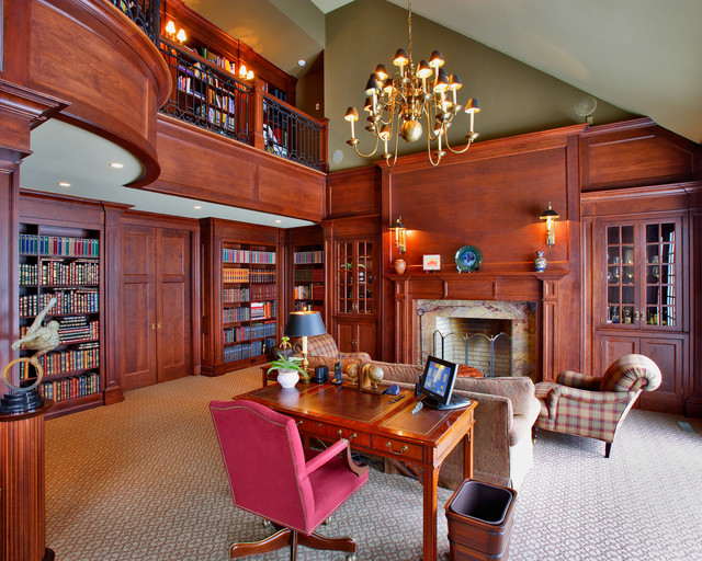 Inspiration for a timeless carpeted home office library remodel in New York with green walls, a standard fireplace and a wood fireplace surround