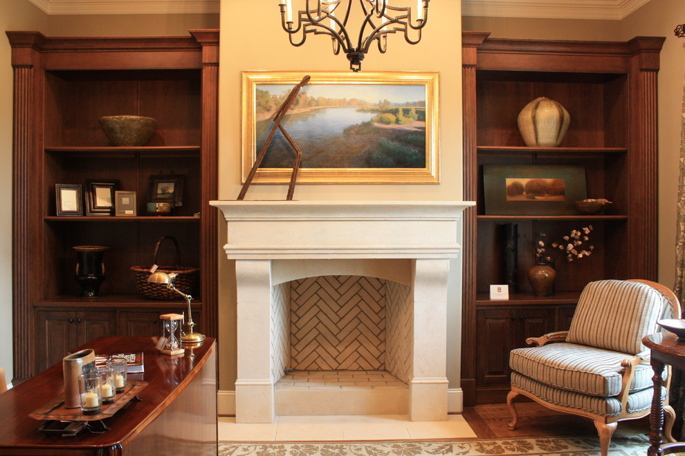Inspiration for a timeless freestanding desk dark wood floor home office remodel in Nashville with beige walls and a standard fireplace