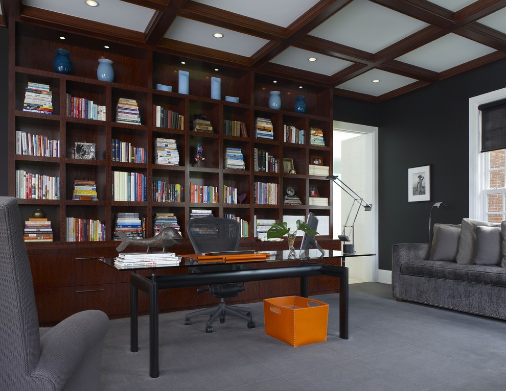 Trendy freestanding desk carpeted home office photo in Detroit with black walls