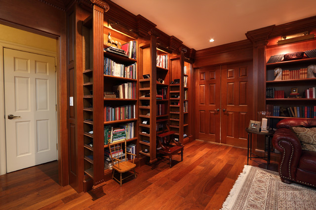 Library With Sliding Hidden Compartments Traditional Home Office